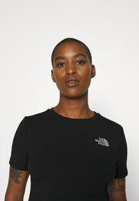 The North Face - CROP TEE - T-shirt con stampa - black - 7