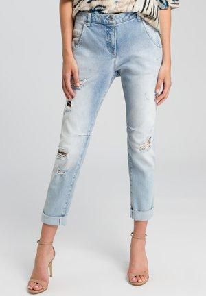 Slim fit jeans - light blue denim varied