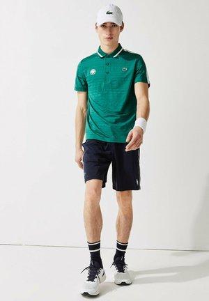 TENNIS  - Sports shirt - grün weiß navy blau