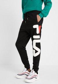 Fila - PURE - Pantaloni sportivi - black - 0