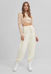 Bershka - Tracksuit bottoms - white - 1