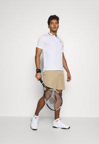 Nike Performance - Sports shorts - parachute beige/black - 1