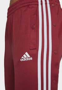 adidas Performance - SNAP PANT - Trainingsbroek - legred