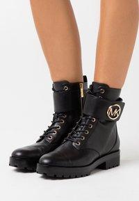MICHAEL Michael Kors - TATUM BOOT  - Lace-up ankle boots - black - 0