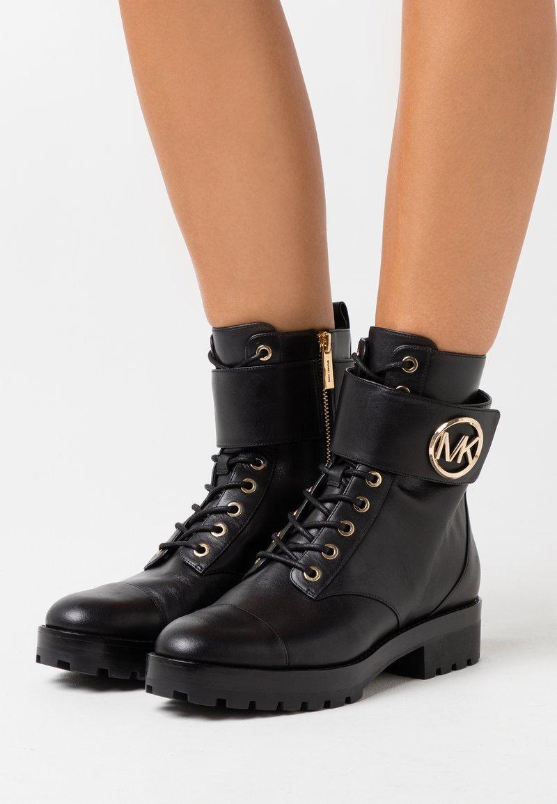 MICHAEL Michael Kors - TATUM BOOT  - Lace-up ankle boots - black