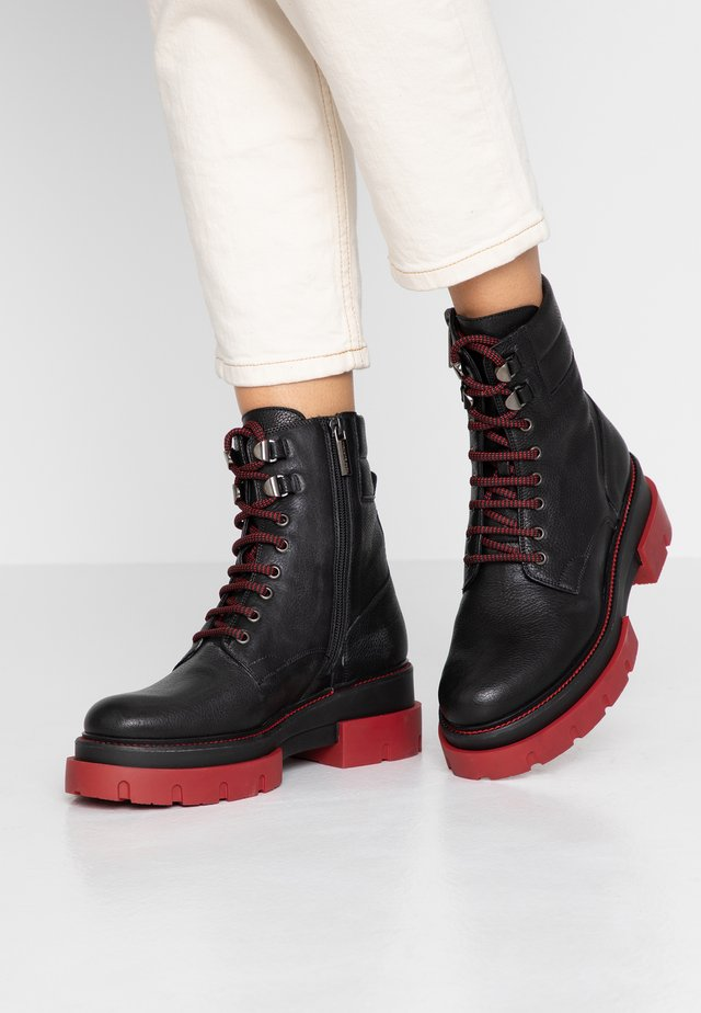 DEBORA - Platform ankle boots - black/red