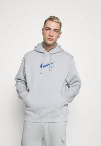 Nike Sportswear - HOODIE AIR  - Hoodie - light smoke grey - 0