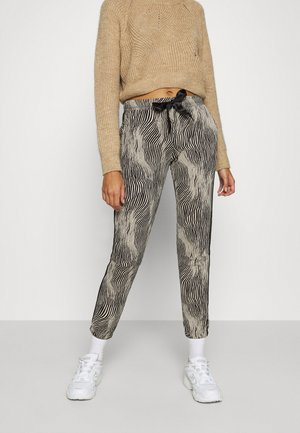 CROPPED ZEBRA - Tracksuit bottoms - beige