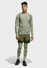 adidas Performance - STUDIO TECH SHORTS - Sports shorts - green - 1