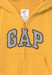 GAP - LOGO  - Jumpsuit - pale gold - 2