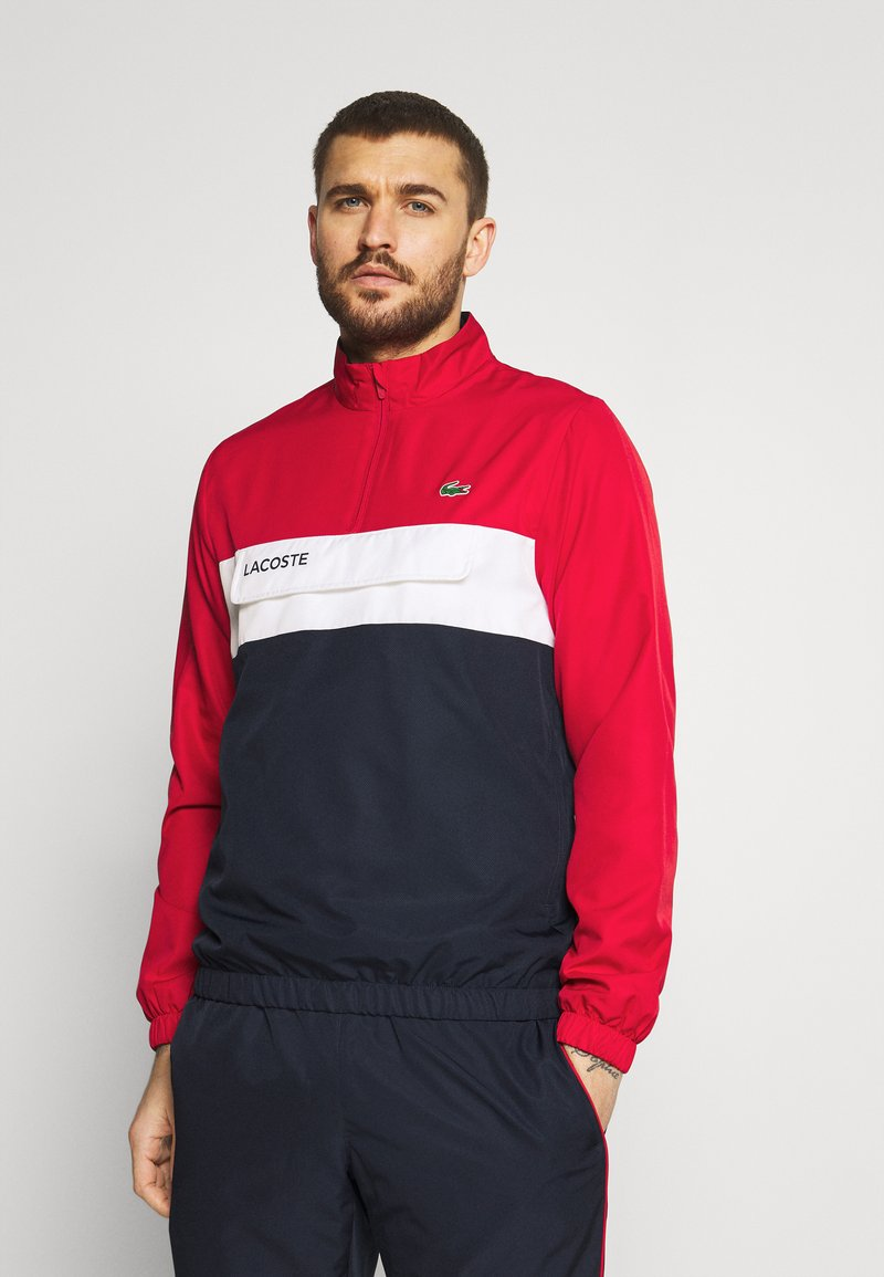 Lacoste Sport - TRACKSUIT - Tracksuit - ruby/navy blue/white