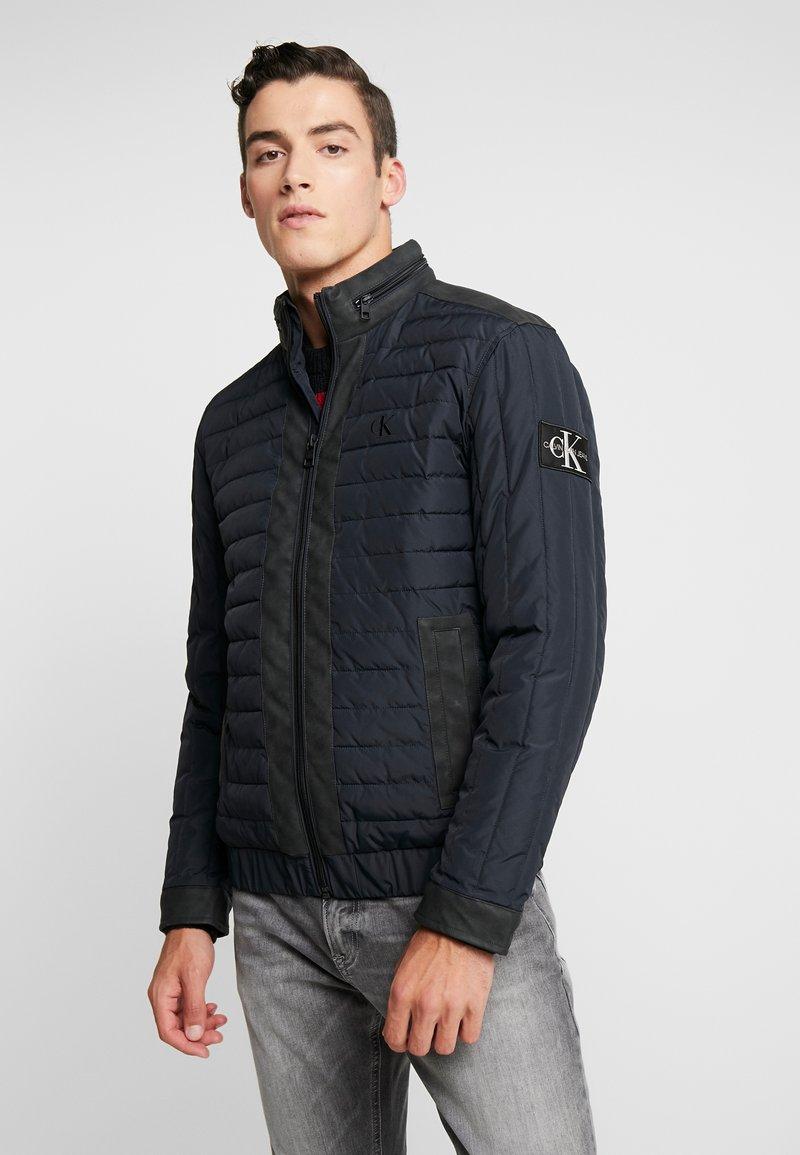 Calvin Klein Jeans - PADDED HOOD ZIP THROUGH - Light jacket - black