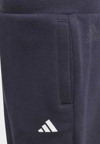 adidas Performance - FLEECE JOGGERS - Tracksuit bottoms - blue - 5