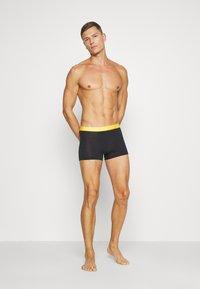 Calvin Klein Underwear - DAYS OF THE WEEK TRUNK 7 PACK - Onderbroeken - black - 0