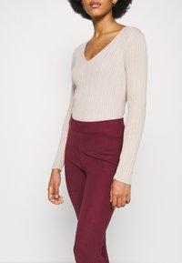 NA-KD - FLARED LOUNGE PANTS - Tracksuit bottoms - burgundy - 3
