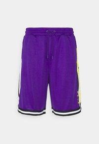 BASKETBALL UNISEX - Tracksuit bottoms - purple