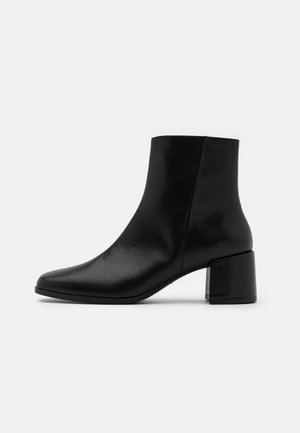 STINA - Classic ankle boots - black