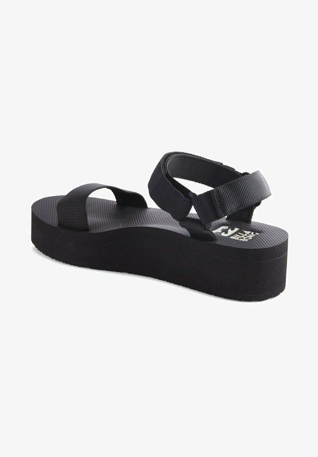 KARI ON  - Wedge sandals - black