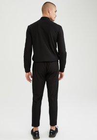 DeFacto Fit - Pantalon de survêtement - black - 2