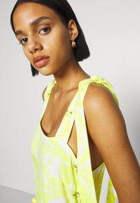 Never Fully Dressed - TIRED POM POM MIDI DRESS - Denní šaty - yellow - 5