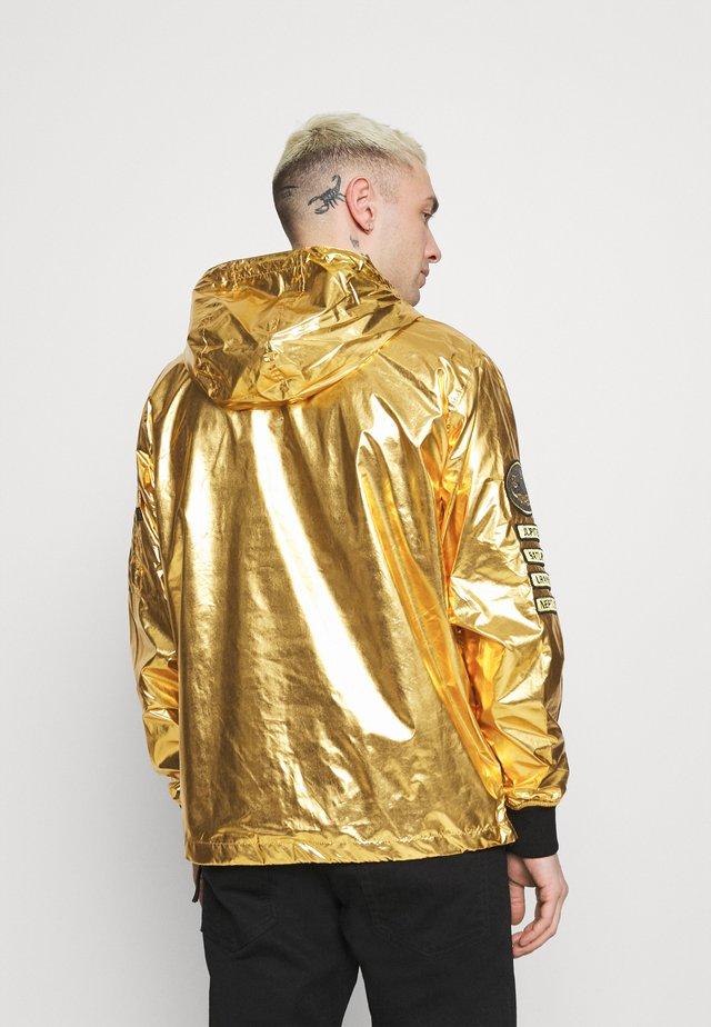 VOYAGER NASA ANORAK - Summer jacket - gold