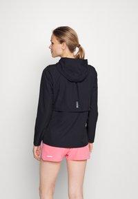 Under Armour - OUTRUN THE RAIN JACKET - Sports jacket - black/white - 2