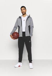 Jordan - AIR PANT - Tracksuit bottoms - black/white - 1