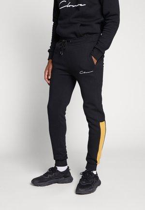 CONTRAST SCRIPT JOGGER - Teplákové kalhoty - black/mustard