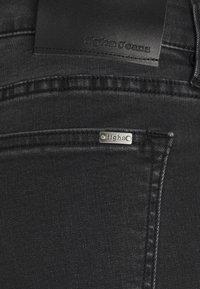 Tigha - ROBIN - Slim fit jeans - black - 2