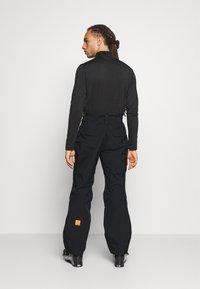 Helly Hansen - SOGN - Spodnie narciarskie - black - 2