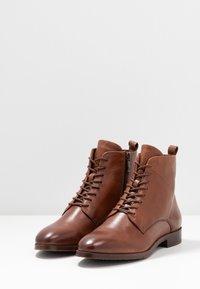 Caprice - Lace-up ankle boots - cognac - 4