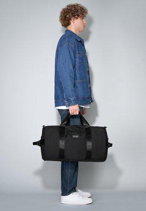 RE-CONSIGNED GARRET XL - Sports bag - black