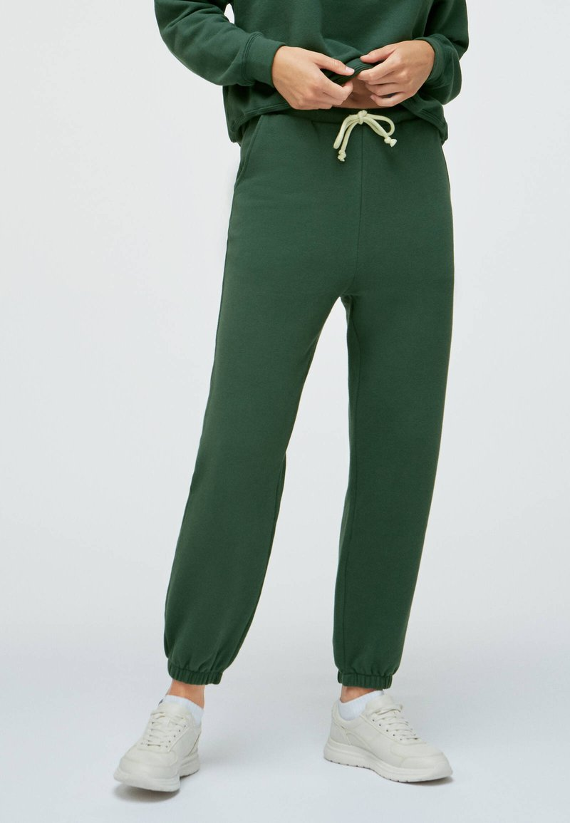 OYSHO - Tracksuit bottoms - green