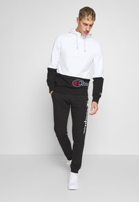 Champion - CUFF PANTS - Trainingsbroek - black - 1