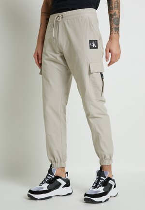 TRACKPANT - Cargo trousers - string