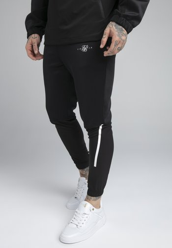TRANQUIL TRAINING PANT - Pantaloni sportivi - black/grey