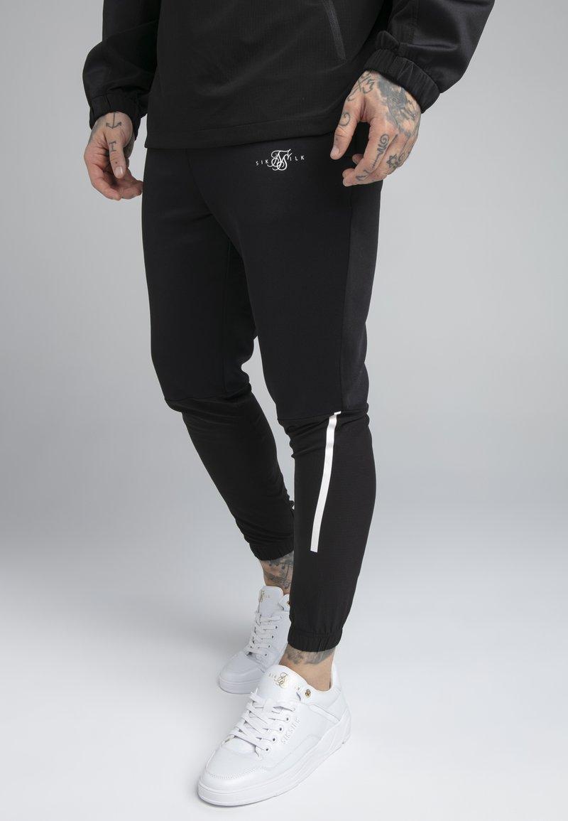 SIKSILK - TRANQUIL TRAINING PANT - Trainingsbroek - black/grey