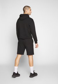 Russell Athletic Eagle R - FORESTER - Tracksuit bottoms - black - 2