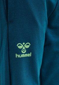 Hummel - Tracksuit bottoms - blue coral green ash - 3