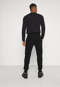 Diesel - PETER TROUSERS - Tracksuit bottoms - black - 2