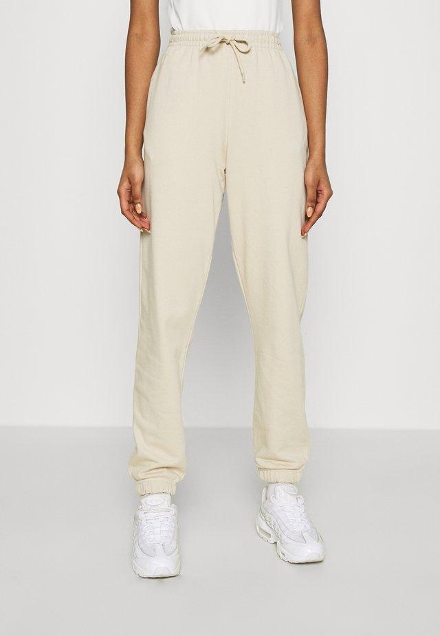 AMAZE - Spodnie treningowe - beige