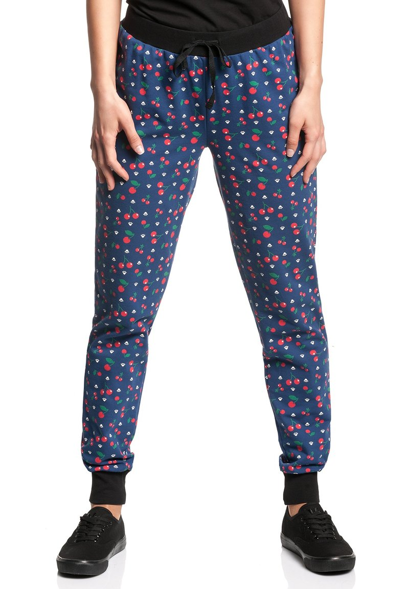 Pussy Deluxe - CAT PAWS & CHERRIES - Tracksuit bottoms - blau allover