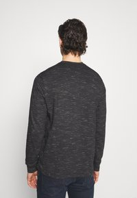 Tommy Jeans - TJM SNIT HENLEY - Long sleeved top - black