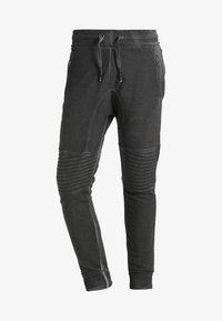 Tigha - TREVOR ZIP - Pantalones deportivos - vintage grey - 5