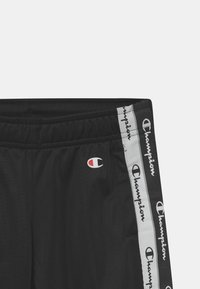 Champion - AMERICAN TAPE ELASTIC CUFF PANTS UNISEX - Verryttelyhousut - black - 2