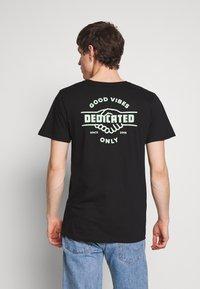 Dedicated - STOCKHOLM GOOD HANDS - Print T-shirt - black - 2