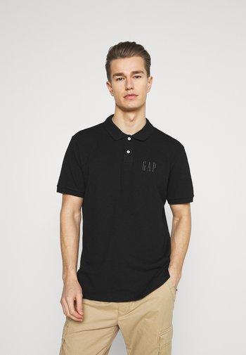 LOGO - Polo shirt - true black