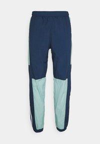 adidas Originals - LIGHTWEIGHT UNISEX - Pantaloni sportivi - hazy green/crew navy - 7