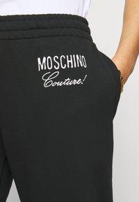MOSCHINO - TROUSERS - Verryttelyhousut - black - 5