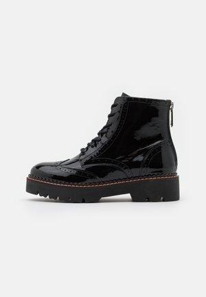 OLIVINE - Platform ankle boots - black
